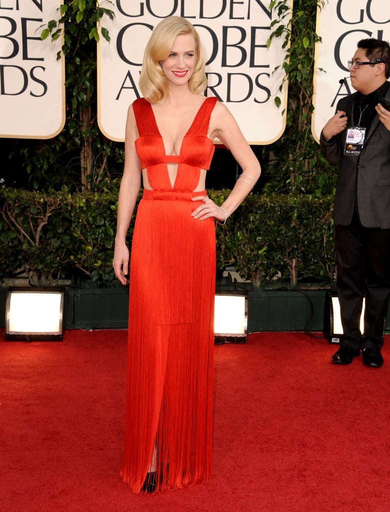 January Jones went bold in red for this evening's Golden Globes in LA! She picked Versace for her latest big appearance at the award show, after she wore a chic Lanvin for last year's event. It was an appropriate choice for the star, since she's in the ads for the company's new handbag lines. January and her Mad Men costars are up for multiple statues tonight, including best TV drama. Jon Hamm and Elisabeth Moss are also in the running for best actor and actress. Weigh in on her look and even more with Fab and Bella's love it or hate it polls!