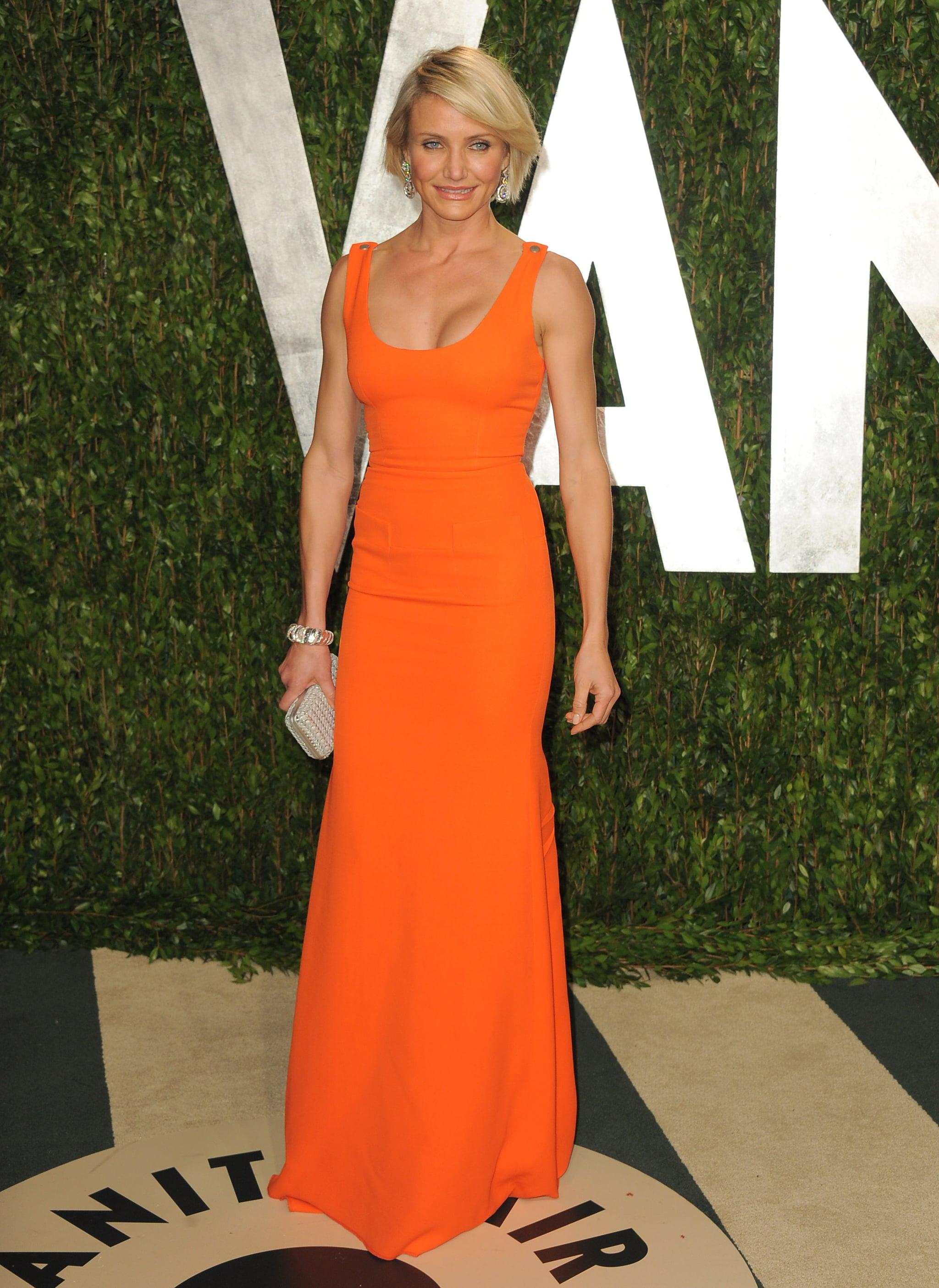 Cameron Diaz wore an bright orange Victoria Beckham gown.