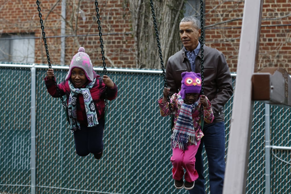 "President Barack Obama is making the most of his final days in office. On Monday, Barack and his wife, Michelle, took some time off from their busy schedules to bond with a group of kids at a service event for Martin Luther King Jr. Day in Washington DC. After donating a playset dubbed Malia and Sasha's Castle, which was formerly used by his daughters during their time at the White House, he put it to good use by pushing a few kids on the swings. The group even decorated a mural depicting the late civil rights activist at the Jobs Have Priority Naylor Road Family Shelter. While the first lady kept things casual in a plaid shirt and dark pants, Barack sported a button-down shirt, a leather jacket, and his signature ""mom jeans,"" as Michelle likes to call them. It goes without saying that we are going to miss sweet moments like this when they leave the White House."