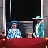 Pictured: Prince William, Queen Elizabeth the Queen Mother, Prince Harry, and Princess Diana.
