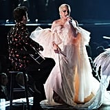 Wearing the most angelic Armani Privé dress for her performance at the Grammy Awards.