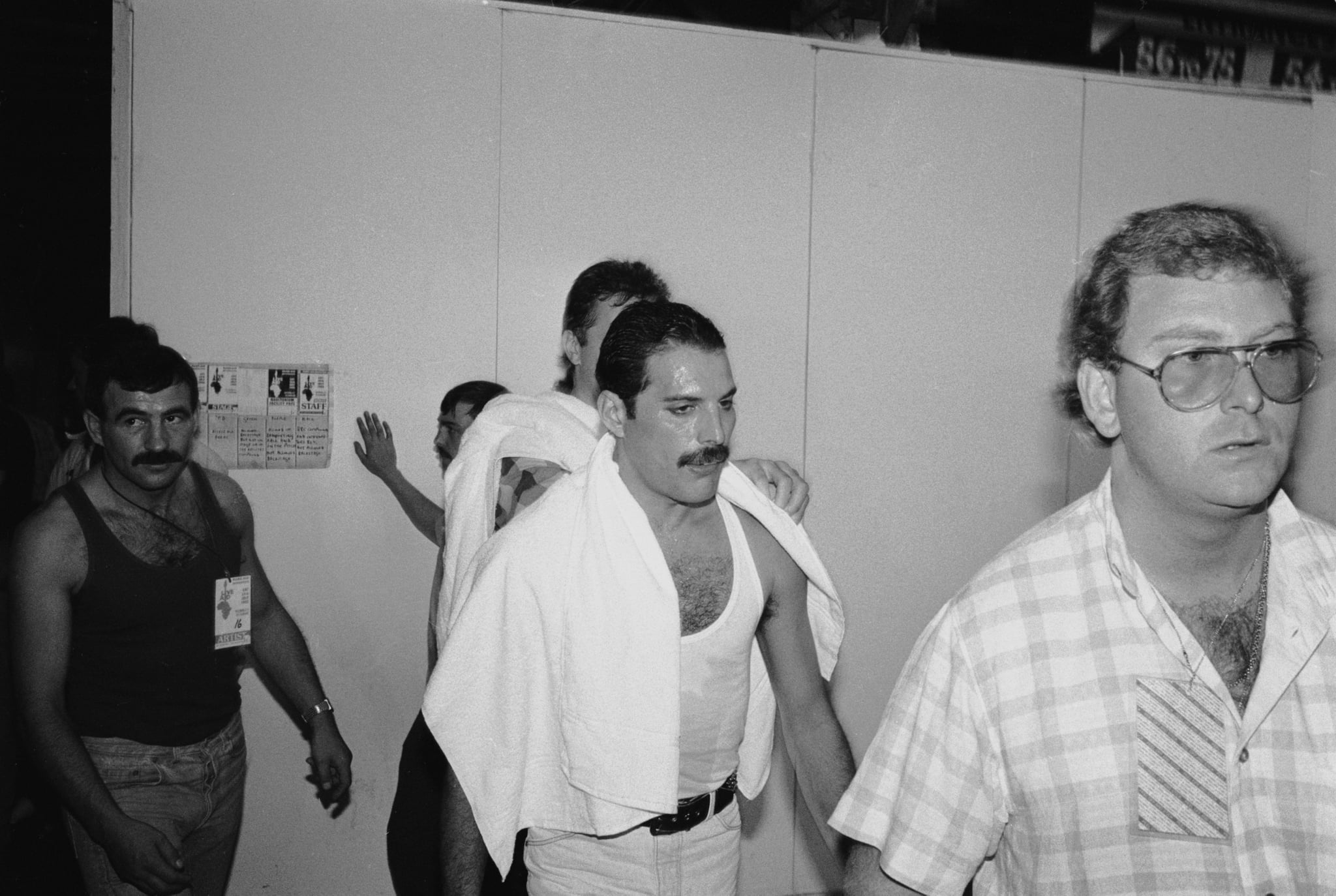 Rock star Freddie Mercury backstage at the Live Aid concert at Wembley, 13th July 1985. On the left is his boyfriend Jim Hutton. (Photo by Dave Hogan/Hulton Archive/Getty Images)