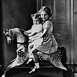 Elizabeth and Margaret posed on a rocking horse together in 1932.