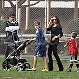 Victoria with Brooklyn and Cruz at a soccer game.