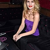 Georgia May stood out in a silky purple tube top, which she made fierce via black lace-up pants and a bib necklace at a party in Paris.