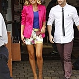 Katherine Jenkins teamed floral shorts with an on-trend neon pink blazer as she joined Mark Ballas on Extra at The Grove in Los Angeles.