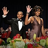 The Obamas flash matching waves at the White House Correspondents' Association annual dinner.