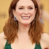 Julianne Moore's circular purple Chopard earrings certainly didn't take away from the bright color of her Givenchy number, but they did play up the Ariel effect of her gorgeous look.