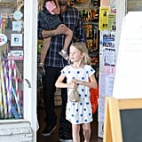 Ben Affleck carried Seraphina out of the store while Violet walked ahead.