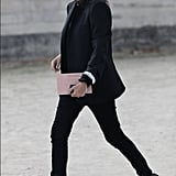 Emmanuelle Alt didn't mess with a good thing; she kept up her signature cool with a slim black blazer, skinny jeans, and rocker-chic pumps.