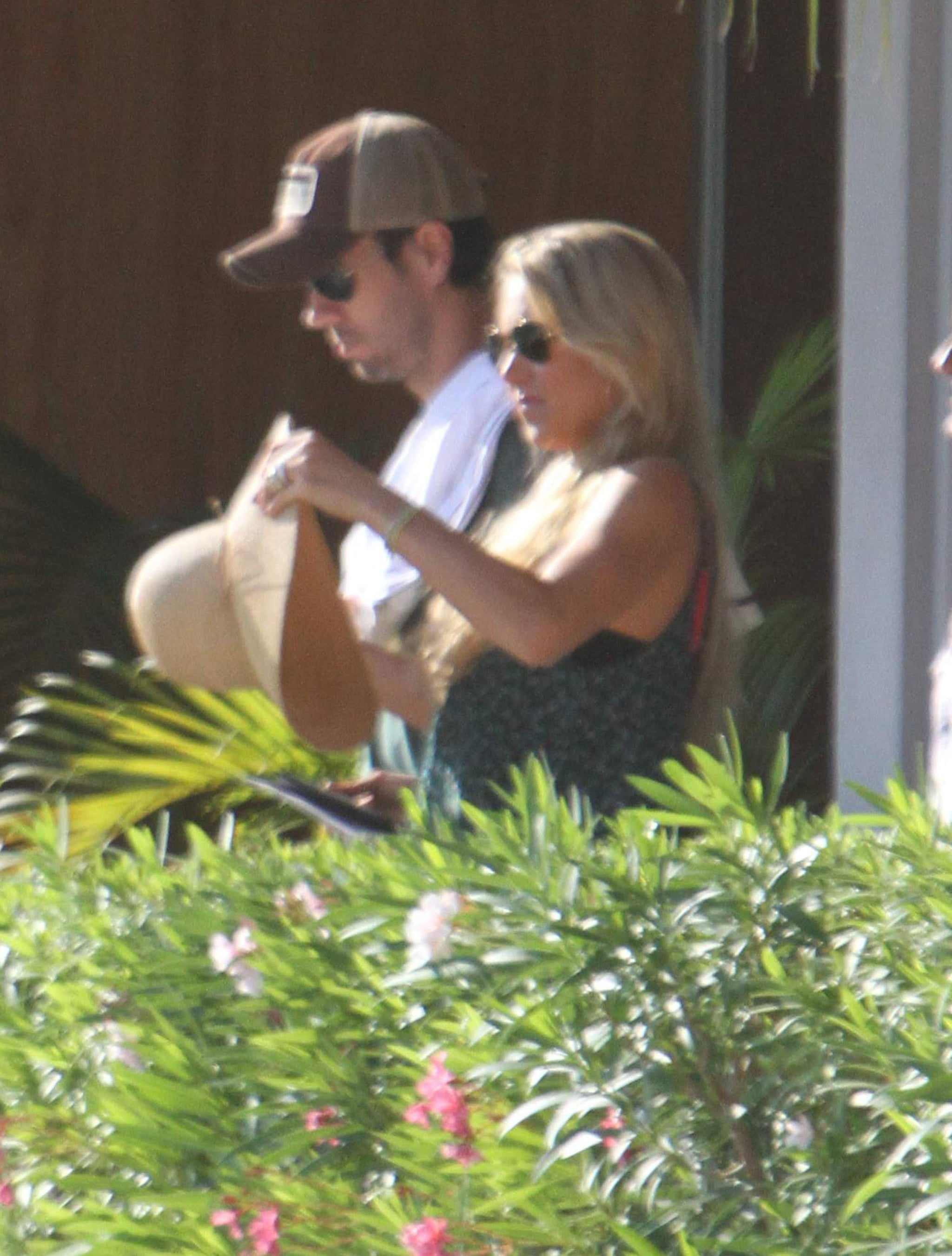 Enrique Iglesias and Anna Kournikova arrived in Cabo together.