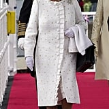 The Queen wore an Angela Kelly coat and dress (which was 12 months in the planning) and accessorised with her signature black Launer handbag and David Hyatt shoes with her standard 2 ¼ inch heel. Her outfit was adorned with Swarovski crystals, threaded silk ribbon and organza frill plus gold, silver and ivory spots.