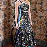 """Amber Heard was a standout in a printed and cutout dress at Stuart Weitzman and W's celebration of """"It Girls""""."""