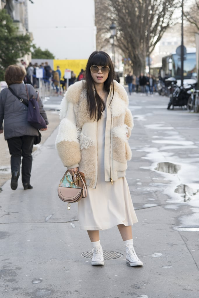 With a White Dress and a Cream-Colored Coat