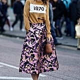 A Brown Jumper, Brocade Skirt, and Trainers