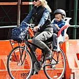 Naomi Watts loaded up her bike with son Sasha Schreiber and a backpack as she rode through NYC.