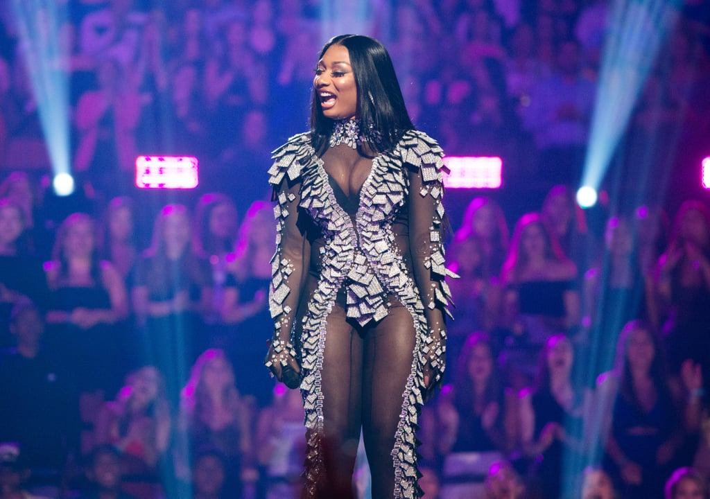 """Megan Thee Stallion capped off her legendary hot girl Summer by making her debut appearance at the 2019 MTV VMAs on Monday. The Houston rapper, who recently released the long-anticipated single """"Hot Girl Summer,"""" titled after her popular phrase, graced the award show red carpet for the first time ever — and she did it oozing sex appeal, as usual.  The 24-year-old has been having a whirlwind Summer, linking up with all sorts of famous peers like her twerk session with the flute-playing Lizzo. Not only did Megan perform for the preshow, but she also won her very first VMA, with """"Hot Girl Summer"""" nabbing the trophy for best power anthem. Keep scrolling for more photos of Megan's sultry studded look, as well as other pictures from her big night!      Related:                                                                                                           Not to Be Dramatic or Anything, but These VMAs Outfits Are the Definition of Fierce Fashion"""