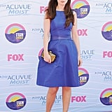 This purple fit and flare dress cinched her waist in perfectly, accentuating her feminine silhouette.