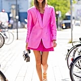 When going bold with your color, don't be afraid of taking it over-the-top but opting for a head-to-toe brightly toned look.