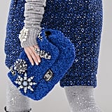 Some Bags Festooned With Crystals Matched the Outfits