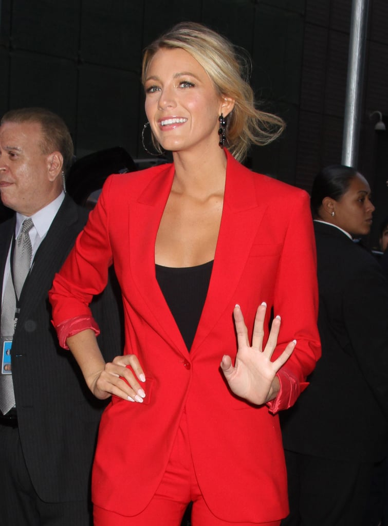 A scoop neckline on Blake's black top gives her suiting a more casual, carefree vibe.