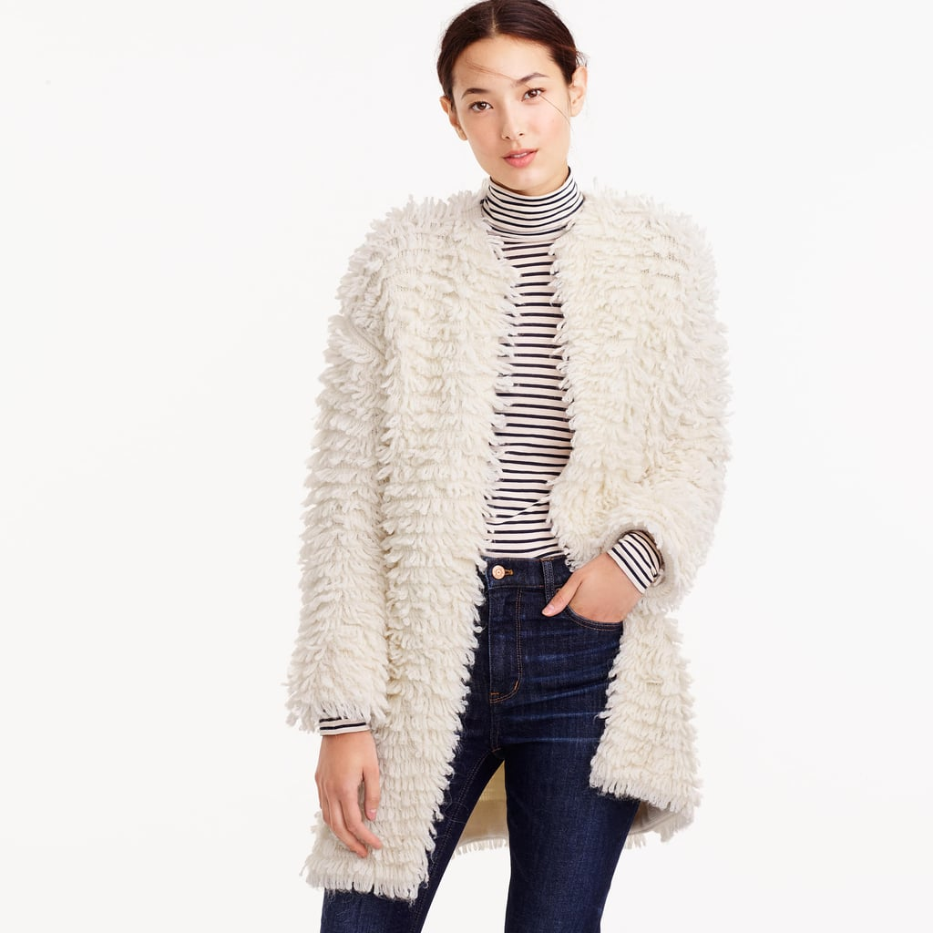 """It's not often that I get excited over cardigans, but when I do, they look like this playful loop sweater from J.Crew ($298). As demonstrated by the model, it can even take a simple striped shirt and jeans combo and turn it super trendy."" — SS"