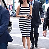 White sneakers are always a good choice for the warmer months, but Gal's decision to pair the canvas shoes with a tight striped knee-length dress proves, yet again, that sneakers work with any type of outfit.