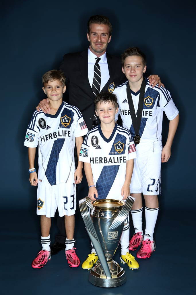 David Beckham posed with sons romeo, Cruz and Brooklyn after his last soccer match with LA Galaxy on December 1. In a fitting send-off, Galaxy won the game, 3-1.