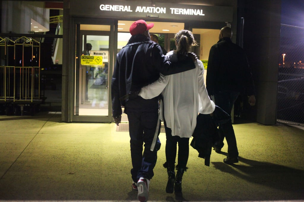Jay Z and Beyoncé held on to each other as they headed to the airport in 2012.