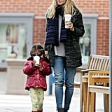 Heidi Klum matched up a tweed coat with a contrasting striped scarf, then completed her LA look via lightwash skinny jeans and Rag & Bone booties.