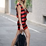From the bright striped dress to her cool Stella McCartney chain bag, this bold look is ideal for a night out on the town.  Photo courtesy of lookbook.nu