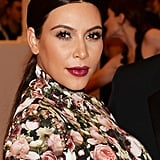 People couldn't stop talking about Kim's Met Gala ensemble, but we thought her low, center-parted ponytail and deep berry lip were pretty flawless.