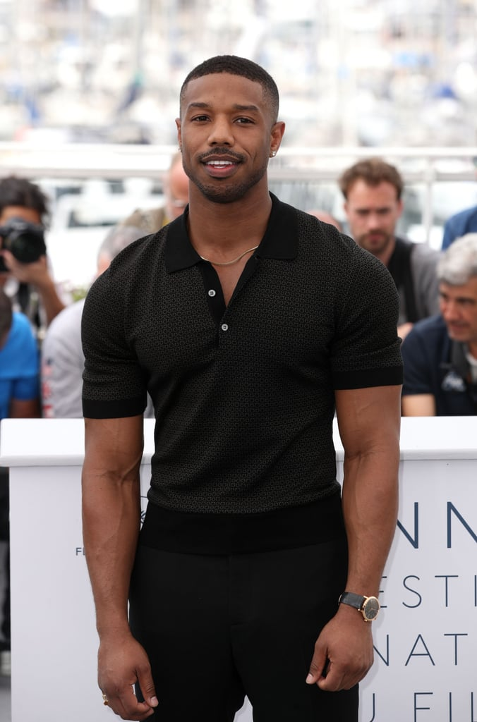 Michael B. Jordan stepped out looking like a million bucks at the 71st annual Cannes Film Festival in Cannes, France on Saturday. The Black Panther actor, who's currently shooting the sequel to 2015's boxing drama, Creed, could barely contain his bulging biceps in a short-sleeved shirt which was unbuttoned at the top and more than enough hotness to make us need smelling salts.  The 31-year-old star was on hand for a photocall with his Fahrenheit 451 costars Michael Shannon and Sofia Boutella, along with director Ramin Brahani ahead of its HBO premiere later that day. Not only did Michael appear to be in great spirits, cracking jokes with his cast mates in many of the snaps, but he also didn't mind flexing his muscles for photographs either. See more photos from Michael's swoon-worthy day at the film festival ahead, then check out how other Hollywood stars are bringing the glamour to Cannes. Ready, set, go!