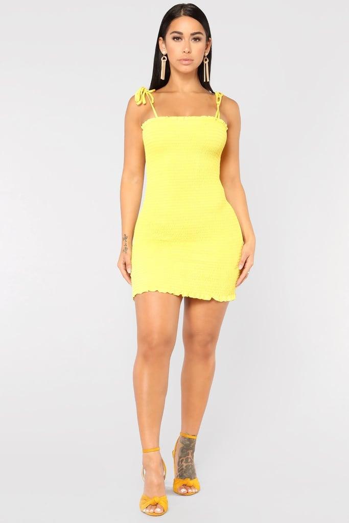 3952ace9e9c Kourtney Kardashian Yellow Reformation Dress and Chanel Bag ...