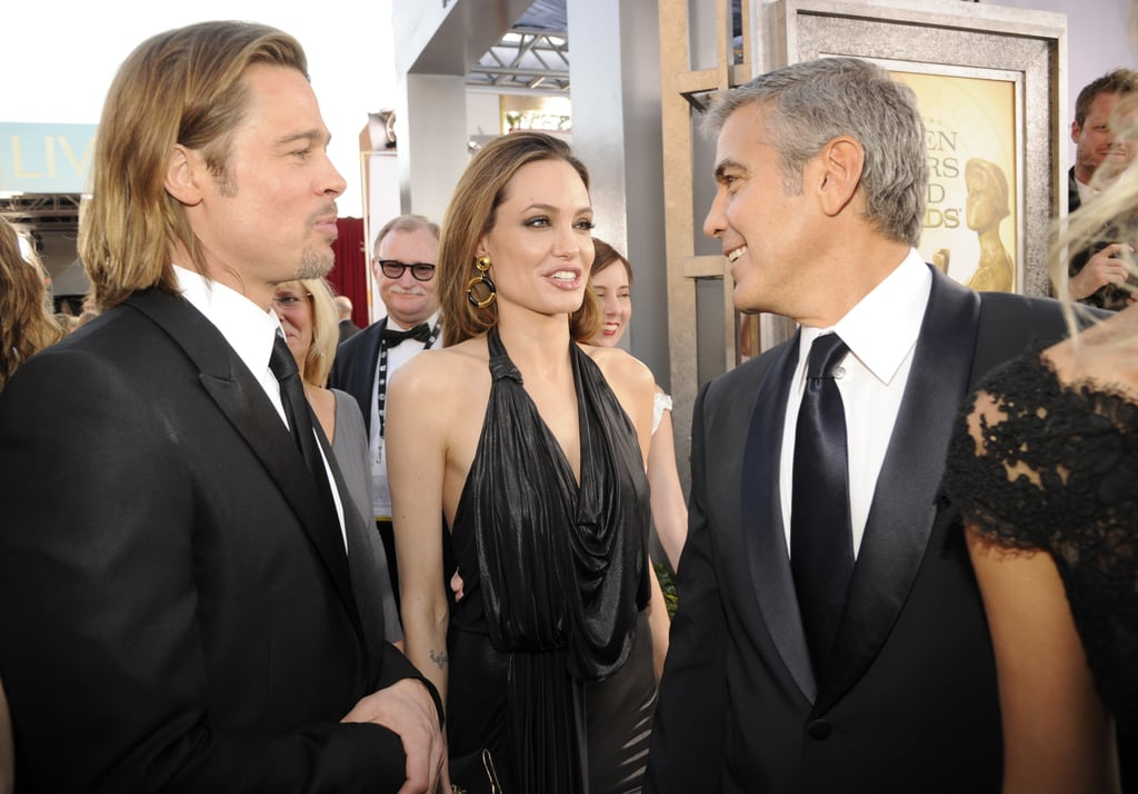 Angelina and George Clooney got to talking on the red carpet.