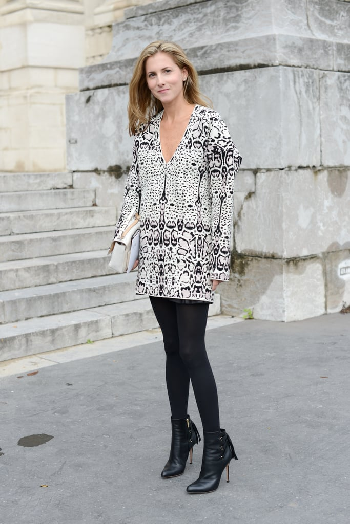 Animal print and fringed booties made this a must-mimic approach to styling a Fall skirt and tights.