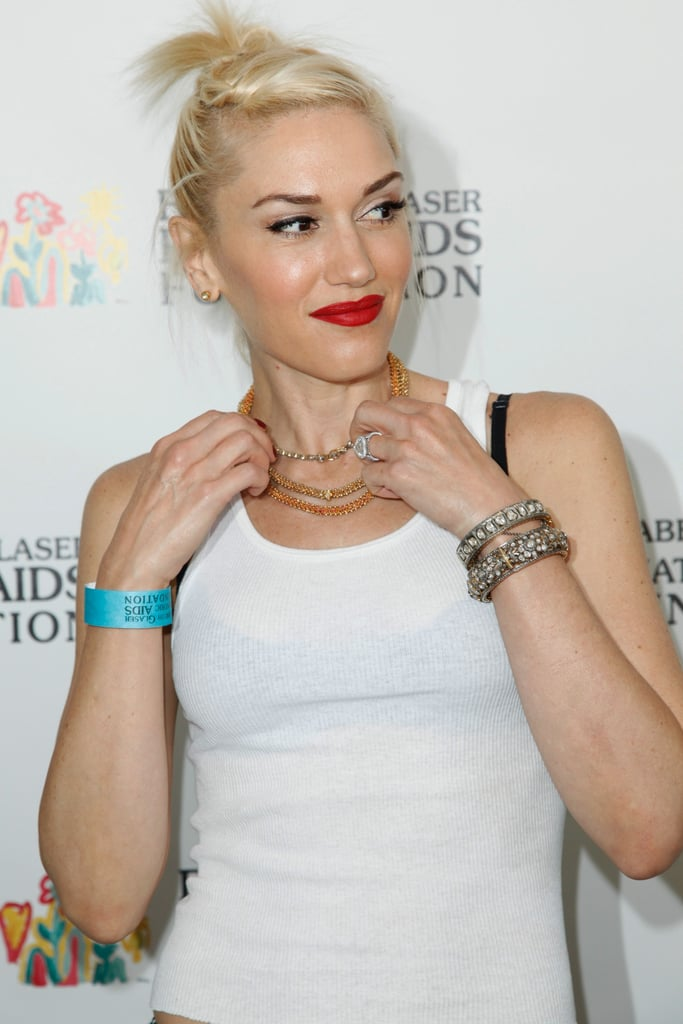 Gwen Stefani adjusted her necklaces at the annual A Time For Heroes Celebrity Picnic in LA.