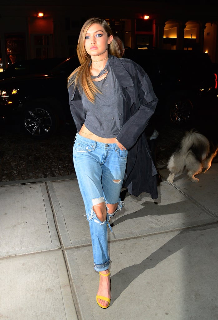 Wearing distressed Rag & Bone jeans with a distressed tee, SMYTHE trench, and Stuart Weitzman sandals.