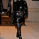 Opting for a The Matrix-inspired look wearing a PVC trench coat and thigh-high boots by Tamara Mellon.