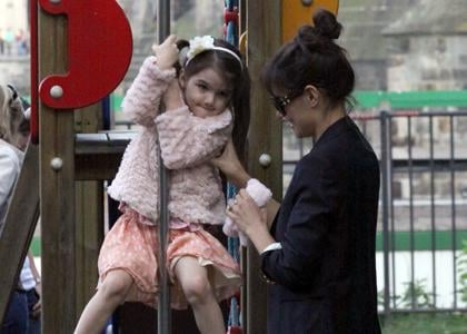 Katie and Suri having fun at a playground in Prague on Thursday (September 23).