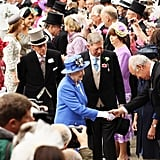 The queen greeted a racegoer.