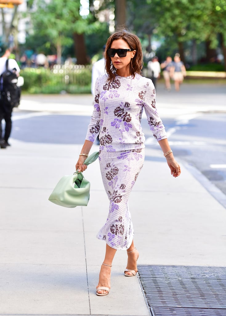 Victoria Beckham Wearing Purple Floral Dress at Fashion Week