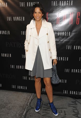 Veronica Webb Wears Blue High-Top Sneakers With Gray Dress and White Trench Coat