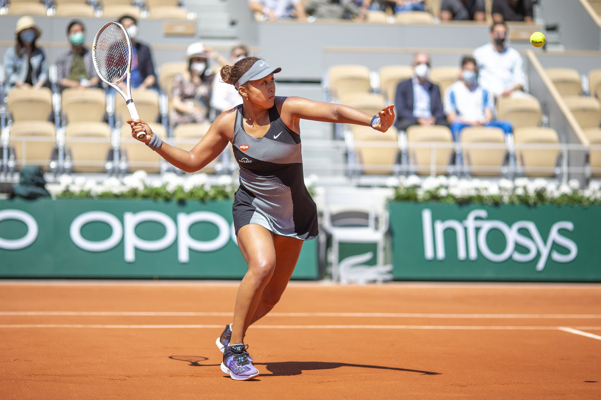 PARIS, FRANCE May 30.  Naomi Osaka of Japan in action against Patricia Maria Tig of Romania in the first round of the Women