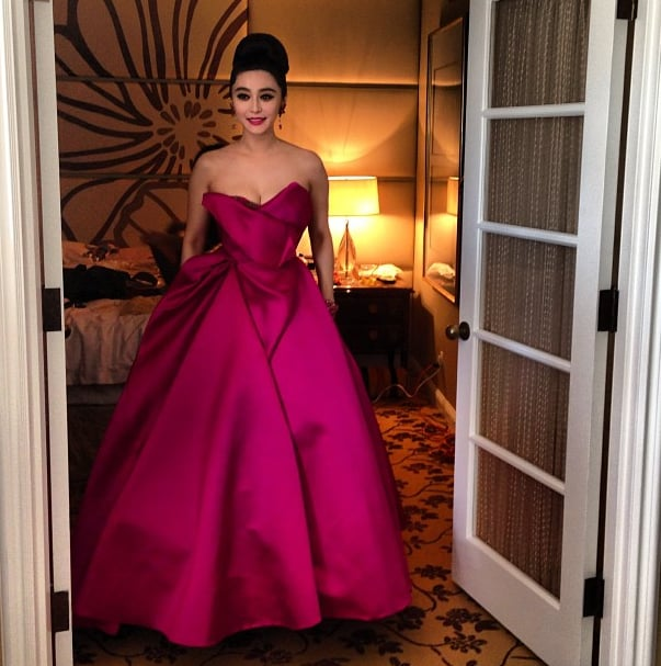 Fan Bing Bing stepped out in a sweeping magenta-hued Marchesa gown. Source: Instagram user marchesafashion