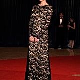 Charlize Theron wore a long black lace dress to the event.