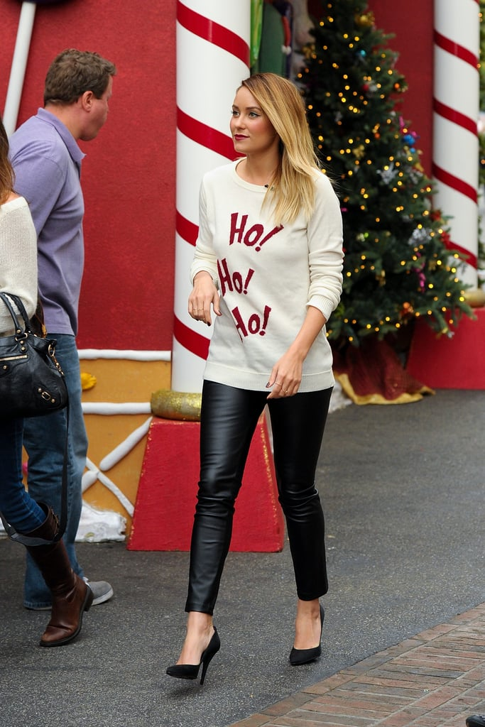 "Lauren Conrad got into the holiday spirit wearing a Lot 78 ""Ho! Ho! Ho!"" sweater as she arrived at The Grove in LA yesterday. She was there for an appearance on Extra and shared her gift picks during the show. If you're still looking for ideas, make sure to check out our holiday gift guides! Lauren is also showing off seasonal content on her website and recently posted ideas for a present exchange and ways to give back this season. She has plenty to be thankful for herself, including her boyfriend, William Tell, as she heads into December. After they started dating in the Spring, LC and William made their public debut on the red carpet at a charity event last month, and this will be their first Christmas together as a couple."