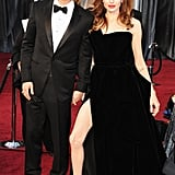 Angelina Jolie showed some leg alongside Brad Pitt at the Oscars in February.