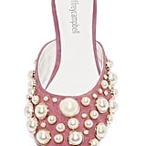 Pearl embellishments are everywhere, and Jeffrey Campbell ($145) plays with the design by incorporating them on the front of his pink slides.