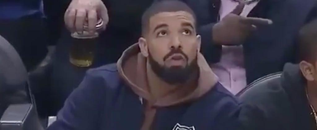 Drake Mixing His Own Drink at Basketball Game
